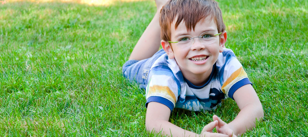 child outside wearing glasses